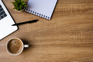 Wall Mural - desk office with laptop, blank notepad, coffee cup and pen on wood table. Flat lay top view copy spce.