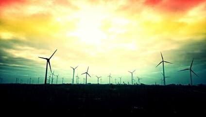 Foto auf Gartenposter Gelb Schwefelsäure Wind Turbines On Landscape Against Sky