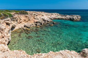 Rocky coastline and transparent water at punta Asparano, near Siracusa, during the summer (Sicily, Italy)