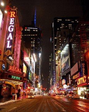 Illuminated Movie Theaters In City Street