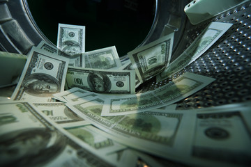 Washing banknotes in machine, money laundering, financial fraud concept