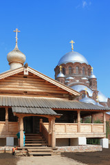 Wooden Trinity Church and dome of stone cathedral. Island Sviyazhsk, Tatarstan