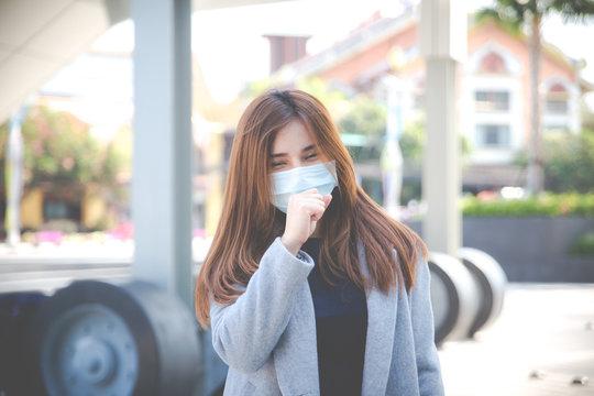 Virus mask Asian woman travel wearing face protection in prevention for coronavirus.
