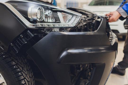 auto mechanic repair car body bumper replacement.