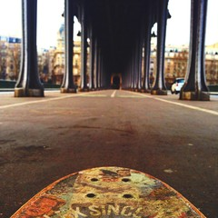 Cropped Image Of Skateboard On Pont De Bir-hakeim