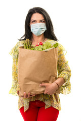 Woman with protective mask and shopping bag