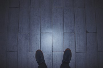 Low Section Of Man Standing On Tiled Floor Wall mural