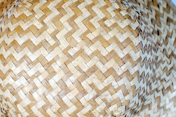 Texture of wicker and glued, beige and brown straws