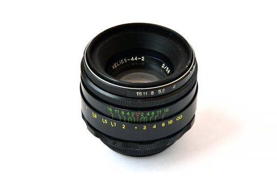 Old Helios 44-2 photo lens on a white background Isolated photographic equipment