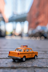 Wall Mural - Taxi model parked on the Washington street in Brooklyn, New York in front of the Manhattan bridge.