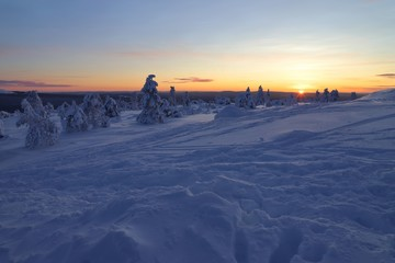 Winter landscape in Finland with low sun on the horizon