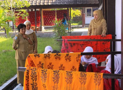 Girls painting in batik school in Mataram Lombok