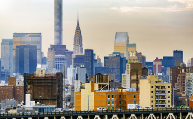 Wall Mural - Amazing sunset skyline of Midtown Manhattan on a cloudy autumn afternoon, New York City, USA