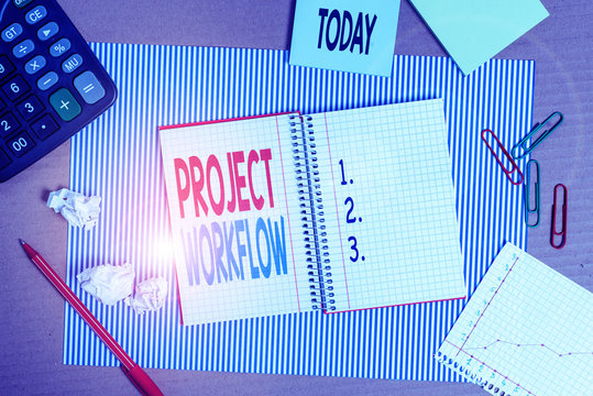Writing note showing Project Workflow. Business concept for series of steps that need to be taken to complete tasks Striped paperboard notebook cardboard office study supplies chart paper