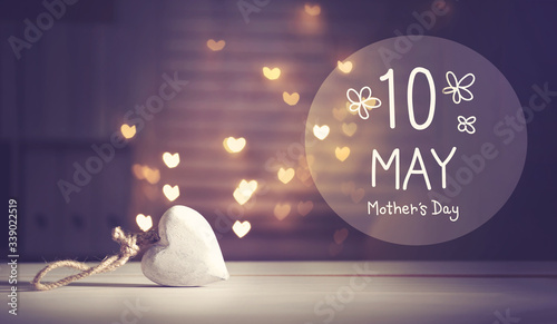 Mother's Day message with a white heart with heart shaped lights