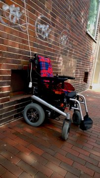 Wheelchair On Sidewalk