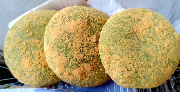 Three green mochi cakes