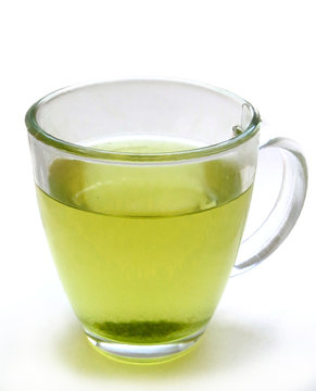 Green tea in a glass mug