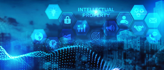 The concept of business, technology, the Internet and the network. A young entrepreneur working on a virtual screen of the future and sees the inscription: Intellectual property