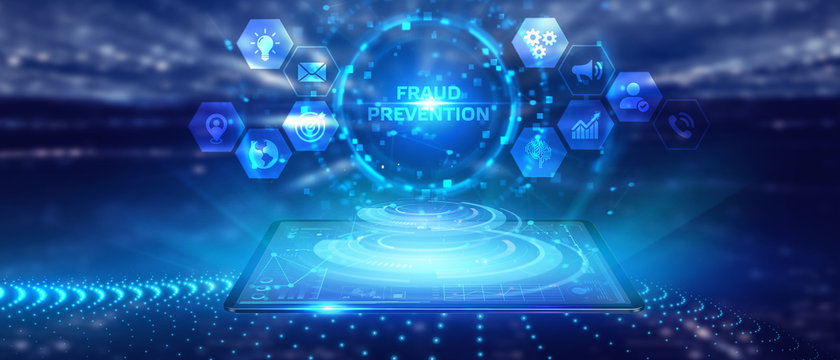 Business, technology, internet and networking concept. Young businessman working on his laptop in the office, select the icon Fraud prevention on the virtual display