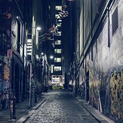 Fototapeta Alley Amidst Buildings In City
