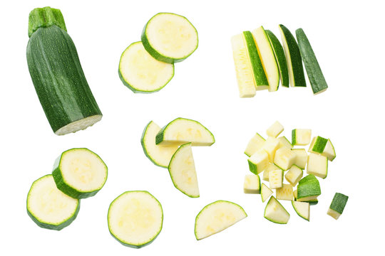 fresh green zucchini with slices isolated on white background. top view