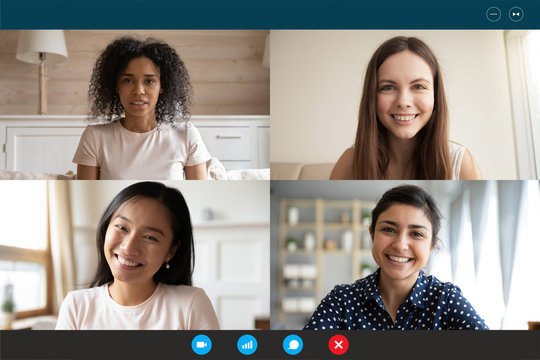 Head shot portrait four multiethnic millennial girls using video call application laptop webcam screen full frame view. Distant chat, virtual communication, modern technology, webinar activity concept