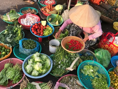 Women selling food on the market of Hoi An, Vietnam