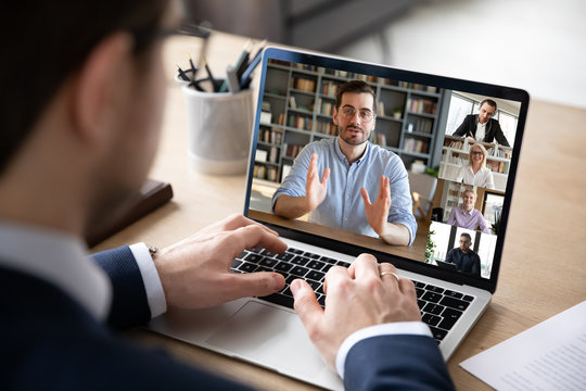 Businessman boss leader leads distant communication diverse businesspeople involved in group videocall conversation discuss common project, partners negotiating. Modern technology and business concept