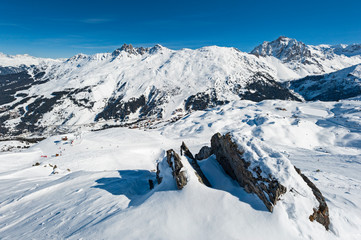 Wall Mural - Panoramic view across snow covered alpine mountain range