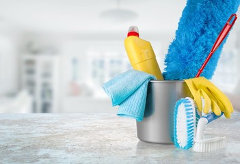 Plastic bottles, cleaning sponges and gloves in bucket