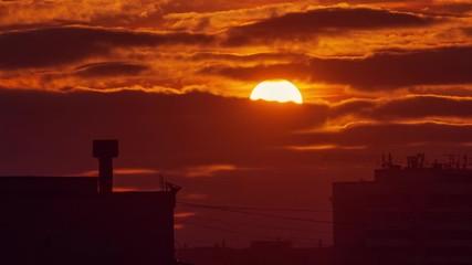 Fotobehang - Beautiful orange sunset sun clouds moving in sky over dark city skyline silhouette. Timelapse, 4K UHD