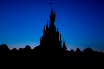 Beautiful castle with backlight and a blue background color Fototapete