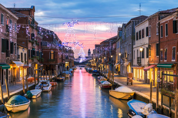 Canal at sunset with Christmas lights, Murano, Venice Fotobehang