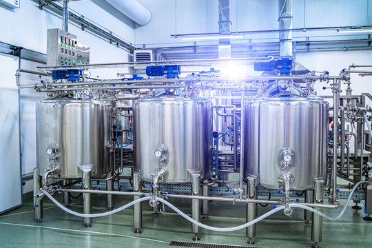 General view of the interior of a milk factory. Equipment at dairy plant.
