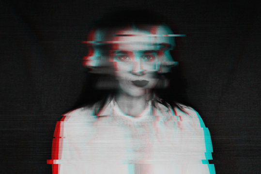 black and white blurred abstract portrait of a girl with mental disorders and schizophrenia with a glitch effect