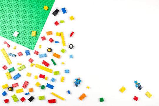 Vilnius, Lithuania - 17 August, 2019: Colorful Lego bricks blocks on white table, top view