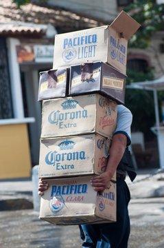PUERTO VALLARTA, MEXICO - Jan 06, 2012: Man delivering cases of Mexican beer