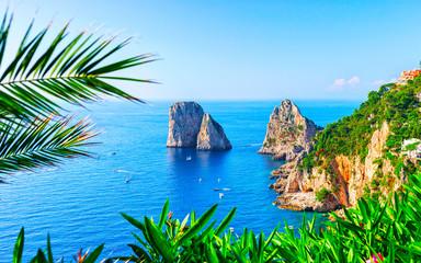 Ships at Faraglioni cliffs and Tyrrhenian Sea of Capri Island reflex Wall mural