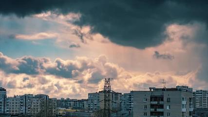 Fotobehang - Dramatic rainy storm clouds moving over city skyline sky background. Timelapse, 4K UHD.