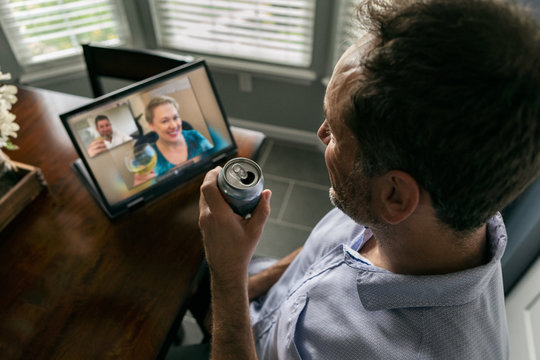 Distancing: Man Hangs Out With Friends During Virtual Happy Hour
