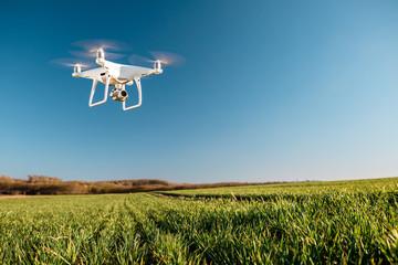 Keuken foto achterwand Blauwe jeans drone quad copter on green corn field