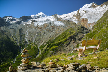 Wall Mural - Just to sit and relax looking at majestic Fee Glacier located above Saas-Fee village