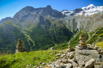Wall Mural - Small rock towers overlooking the Saas valley close to Saas-Fee village