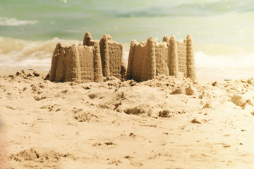 Sand castles on the beach,vacation concept. Holiday concept with sandcastle on the seaside