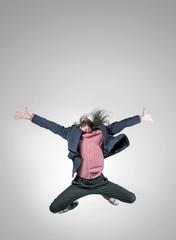 Skinny, elegant man in a jumping pose