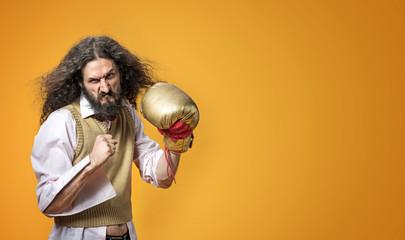Portrait of a dangerous skinny nerd wearing a boxing glove