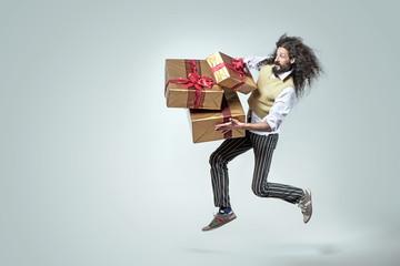 Foto op Plexiglas Artist KB Skinny man running with the bunch of presents