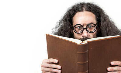 Spoed Fotobehang Artist KB Eccentric, young nerd reading a book