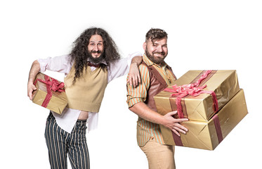 Two cheerful ners holding bunch of presents